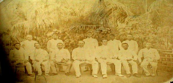 Governor Edward Miller and Corporal Philips Miller with the Officials of  the different Municipalities of Palawan. At the extreme right is Jose Fernandez, the Municipal President of Puerto Princesa
